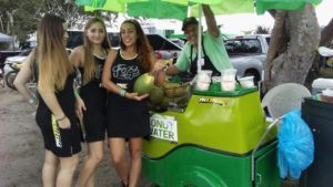 Three Beautiful Girls With Coconut water vender using coco express from juiceindia